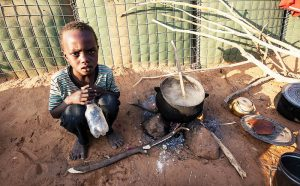 A young boy caught up in the fighting North Darfur, 2015 takes shelter in a refugee camp.