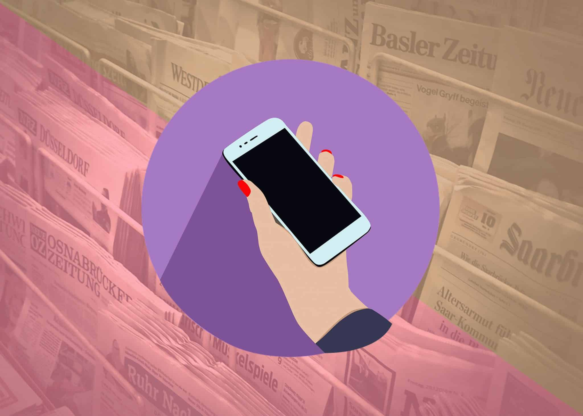 Mobile phone against background of newspapers