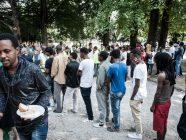 Migrants queuing in Como