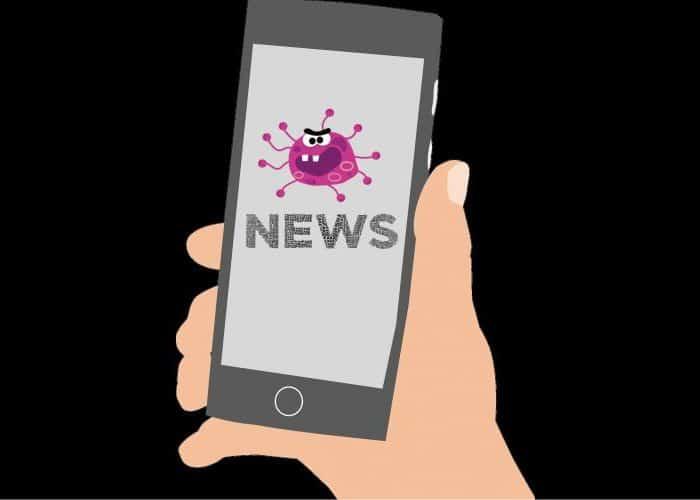 Mobile phone screen displaying cartoon image of coronavirus