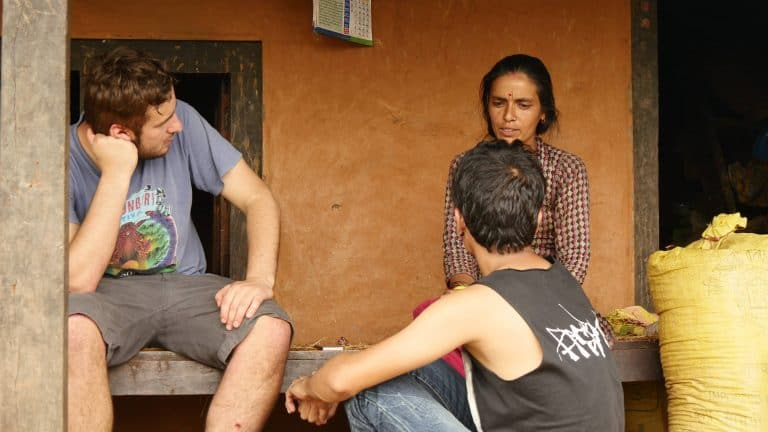 A Bournemouth journalism student talks to an earthquake survivor in Kathmandu