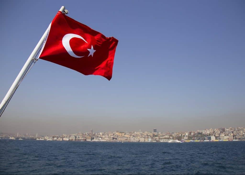 Turkish flag flying over river