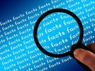 "Magnifying glass held over repeated word ""facts"""