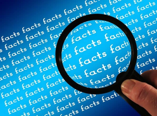 """Magnifying glass held over repeated word """"facts"""""""